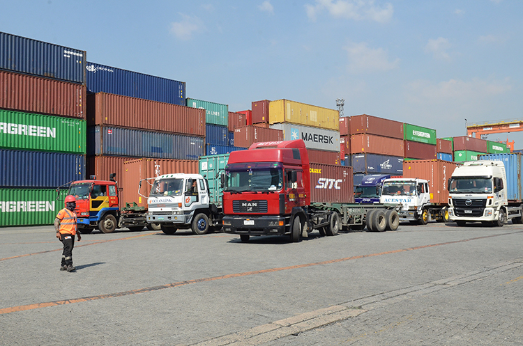 Container trucks inside the Manila International Container Terminal