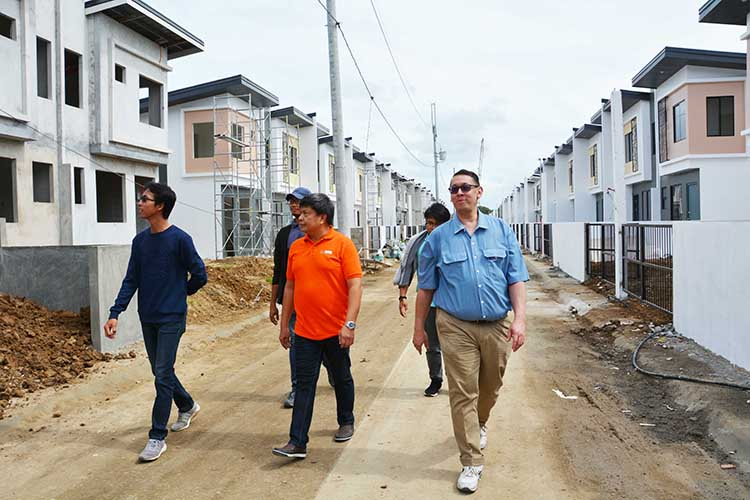 ICTSI officers inspecting houses